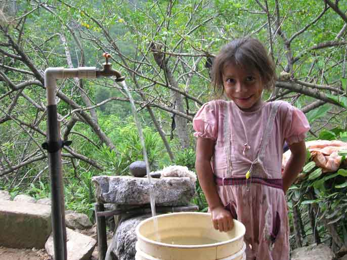 girl with new water faucet in la Calera